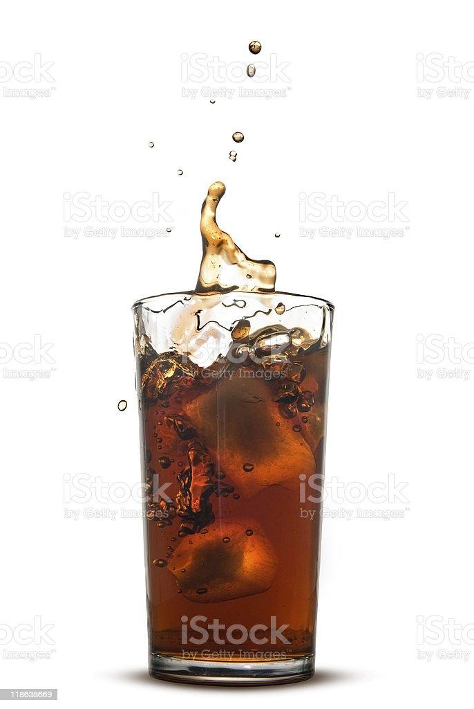 splash of cola in glass royalty-free stock photo