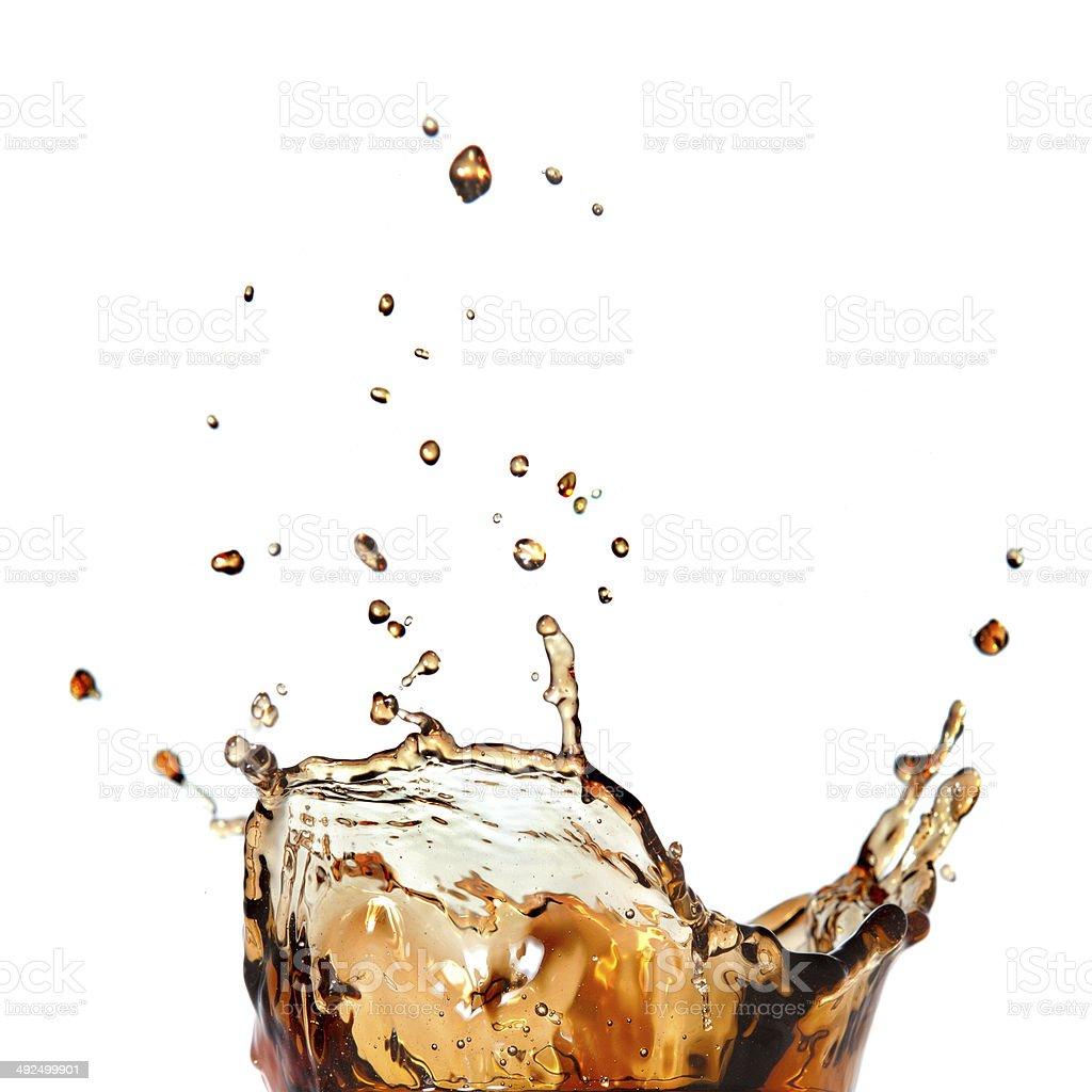 splash of cola isolated on white stock photo