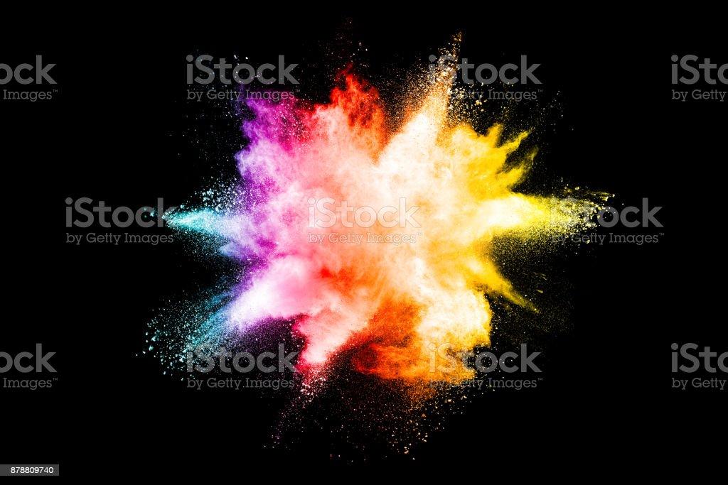 Splash of colorful powder over black background. stock photo
