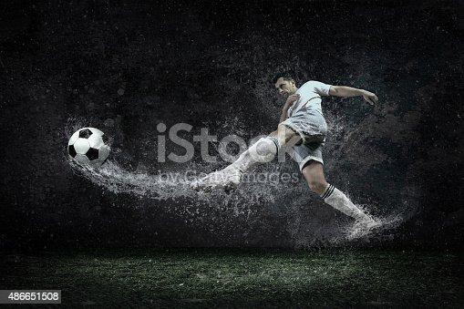 istock Splash of drops around football player under water 486651508