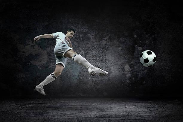 Splash of drops around football player under water stock photo