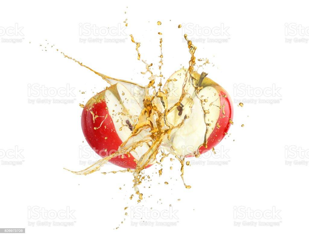Splash of  juice with apple halves stock photo