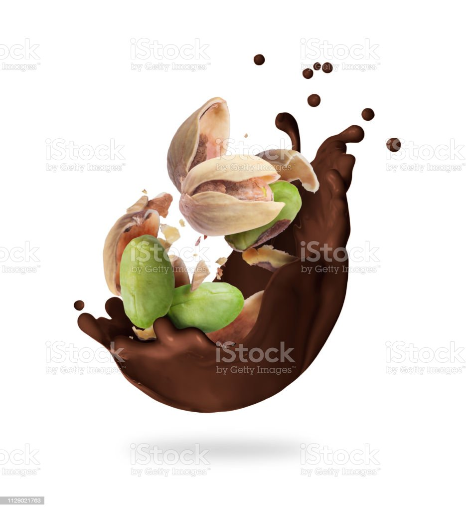 Splash of melted chocolate with crushed pistachios, isolated on white...