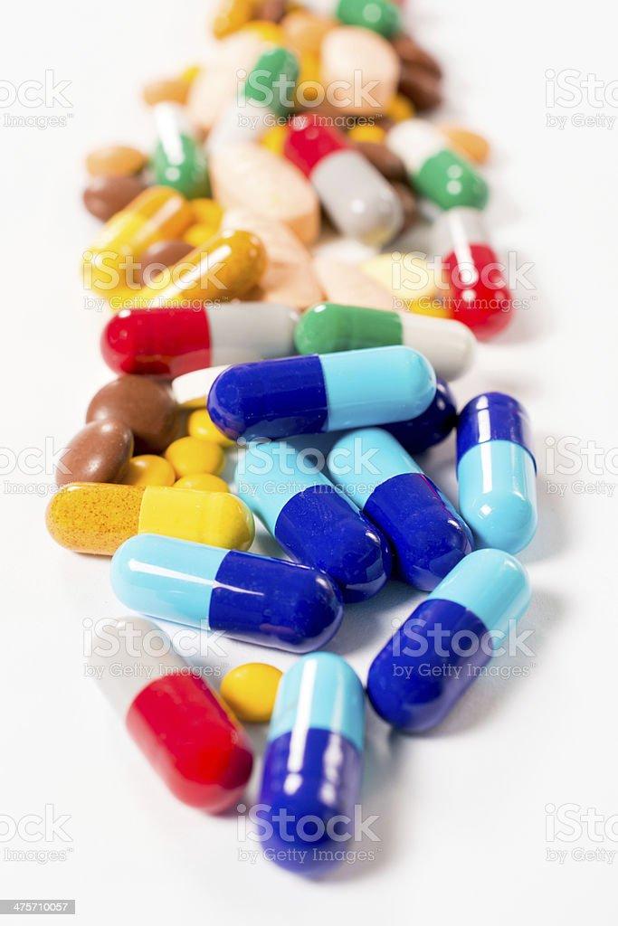 Splashed pills on white background royalty-free stock photo