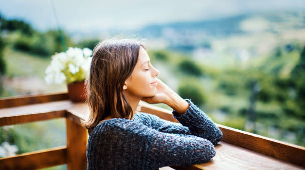Splashed with fresh air. Young woman enjoying a fresh air on the mountain during summer morning. tranquil scene stock pictures, royalty-free photos & images