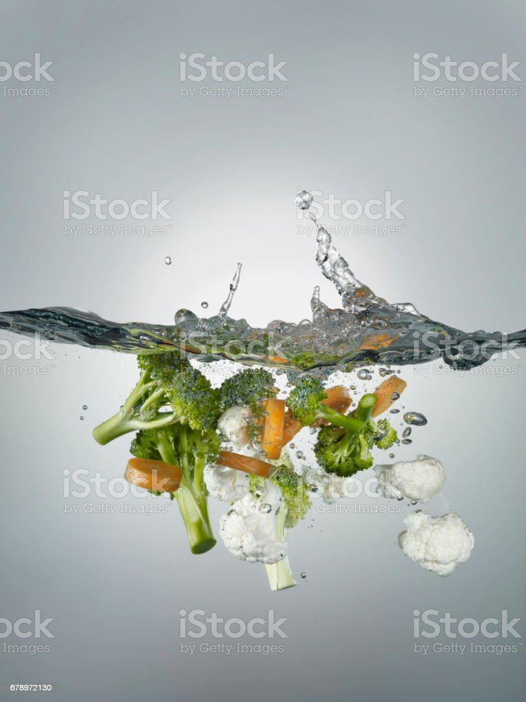 splashes and vegetables stock photo