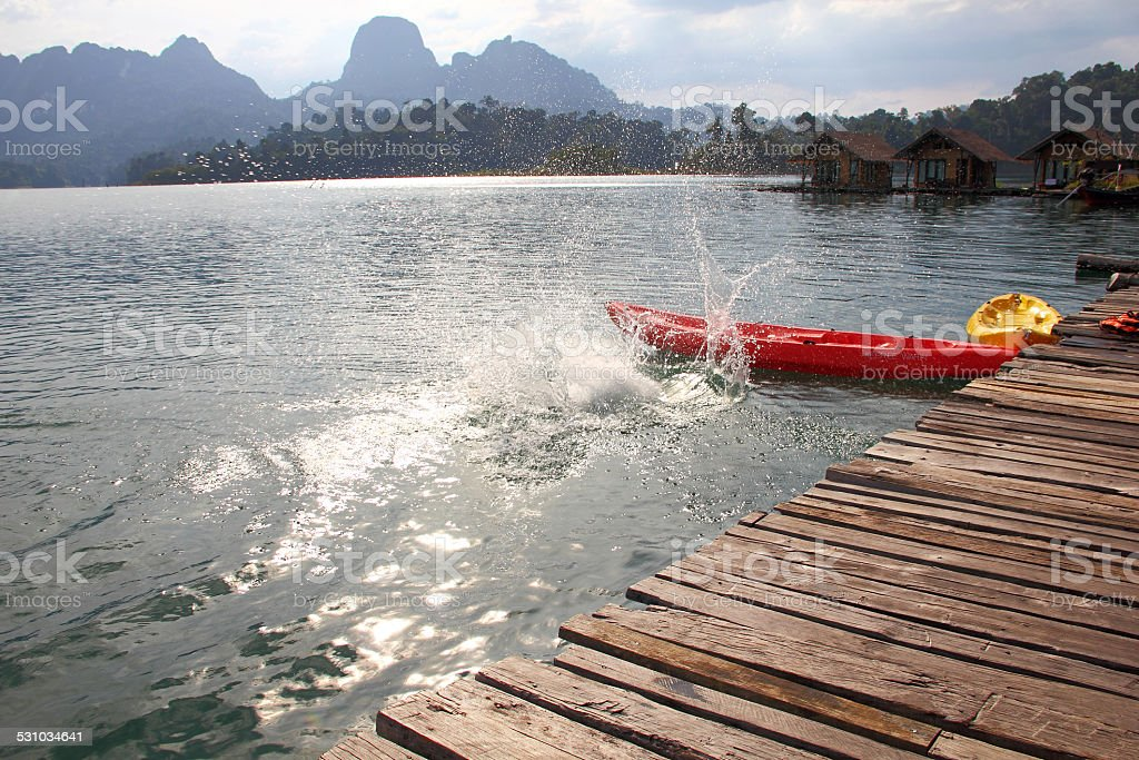 splashes left by people who dived from the pier stock photo