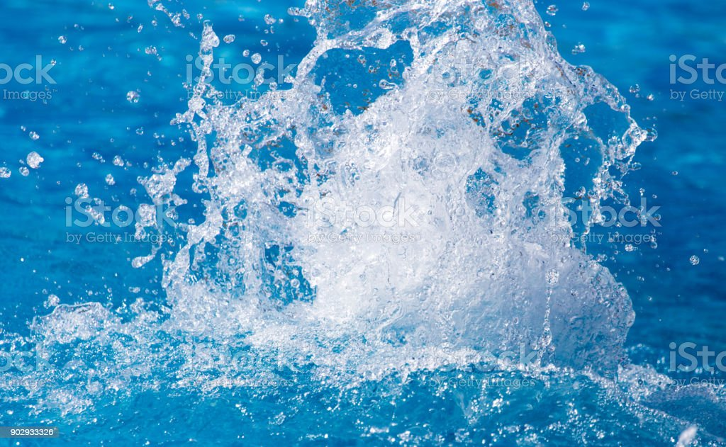 Splashes of blue water in the pool stock photo