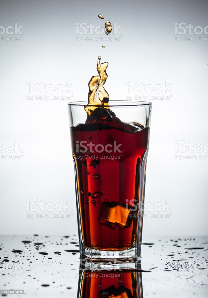 Splashes of drink from a glass stock photo