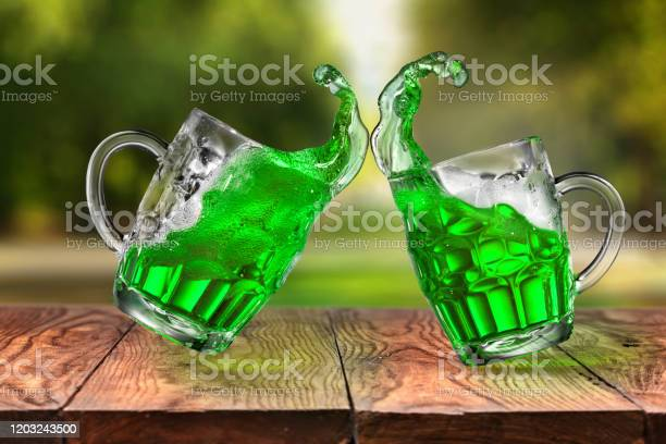 Splashes of fresh green beer in two jumping glasses picture id1203243500?b=1&k=6&m=1203243500&s=612x612&h=t gkv4jqmkymky0mq8gtbiknauos251i nbvwgvgd3a=