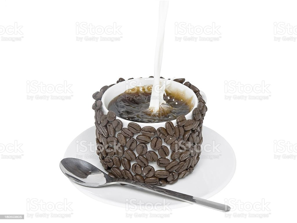 Splashes of poured in milk ,a cup with coffee. royalty-free stock photo