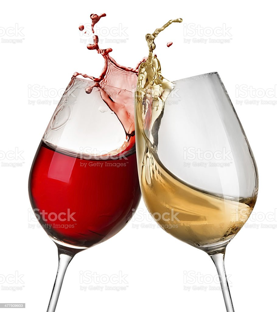 Splashes of wine in two wineglasses stock photo