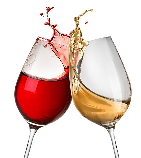 splashes of wine in two wineglasses - wine glass stock photos and pictures