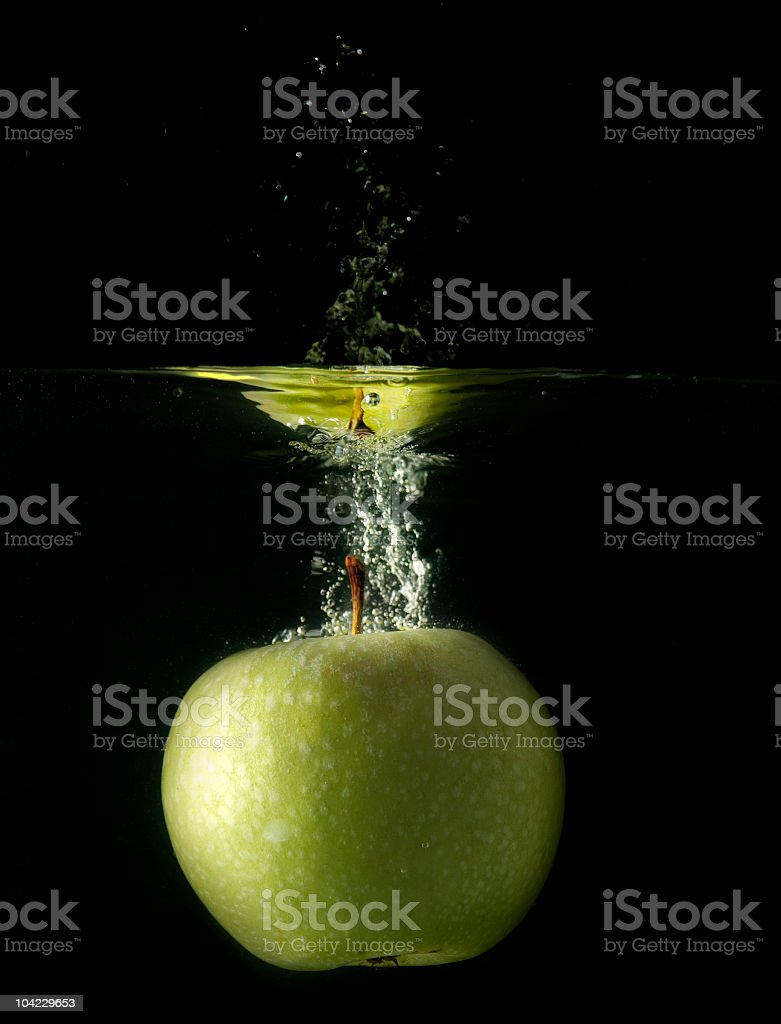 Splashing Apple royalty-free stock photo