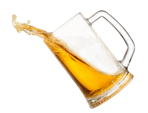 splashing beer in mug - beer pour stock photos and pictures