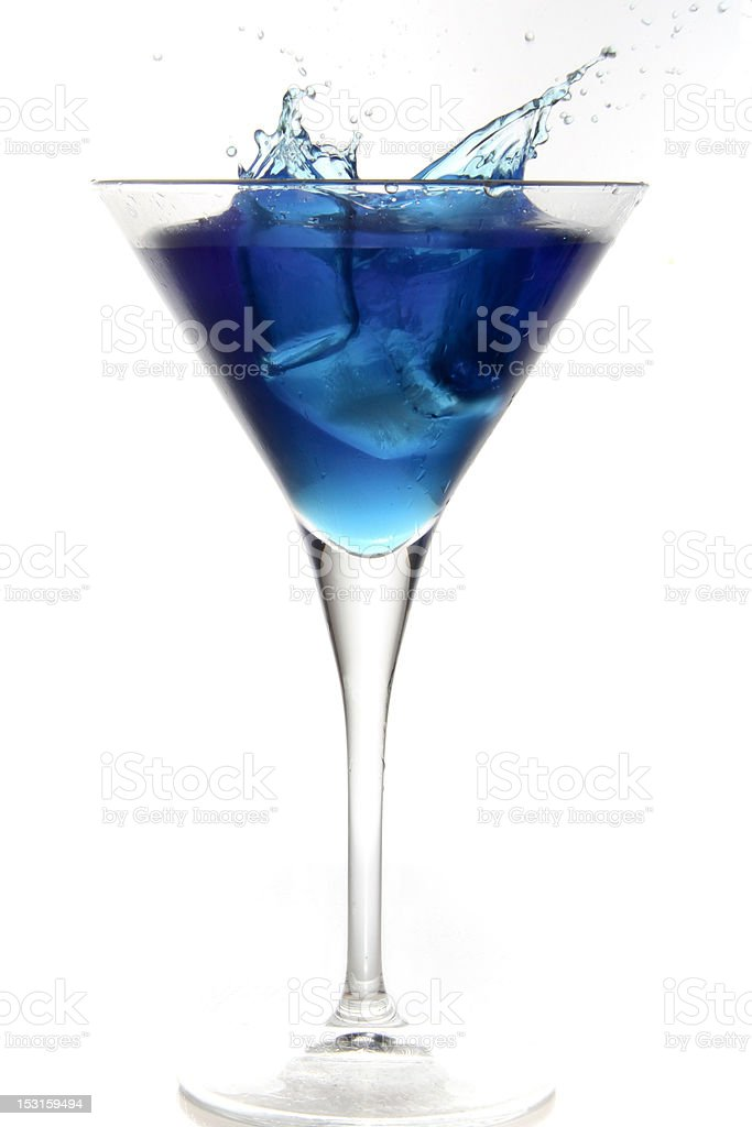 Splashing blue Curacao cocktail in martini glass stock photo