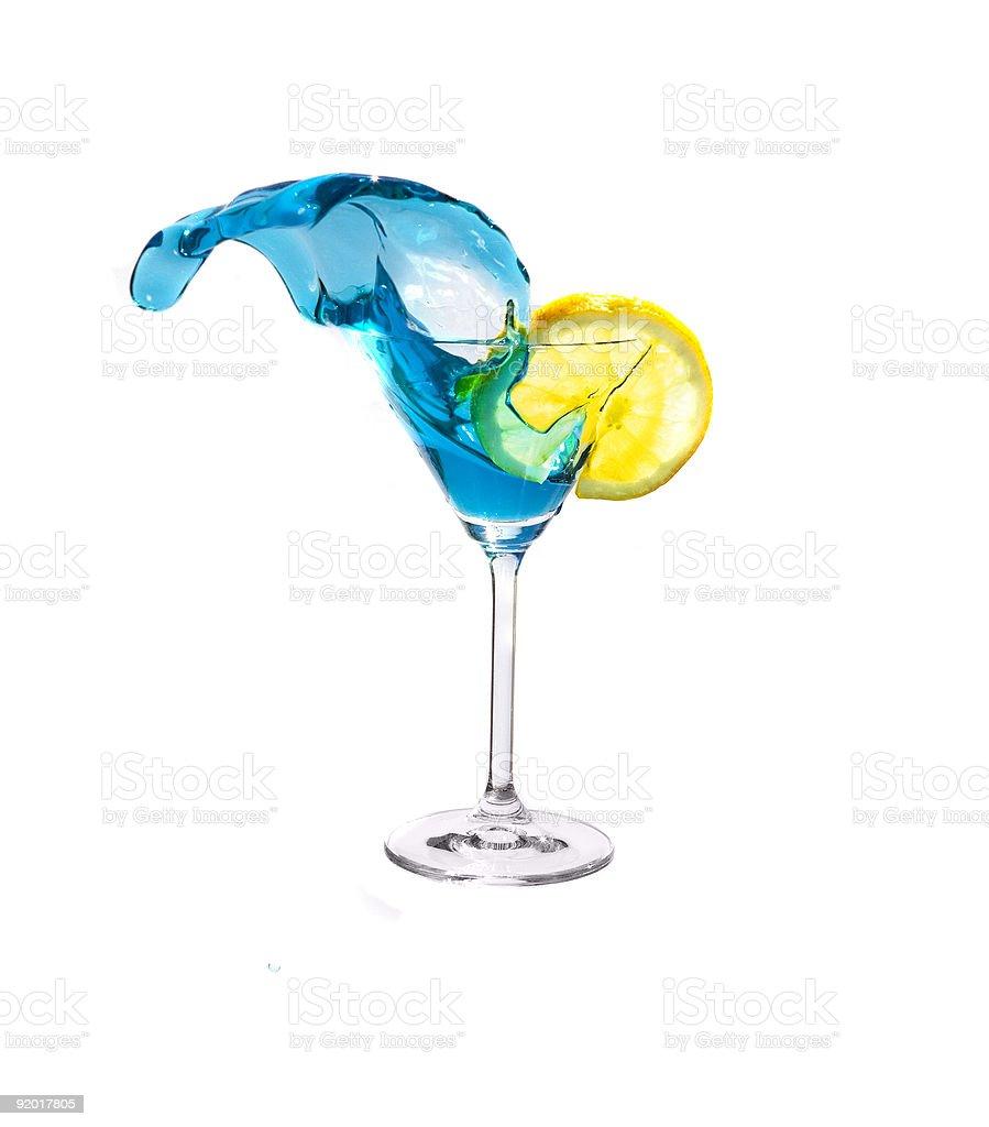 Splashing blue martini and lemon. stock photo