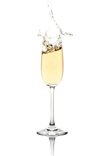 spritzendes wasser champagner - sektglas stock-fotos und bilder