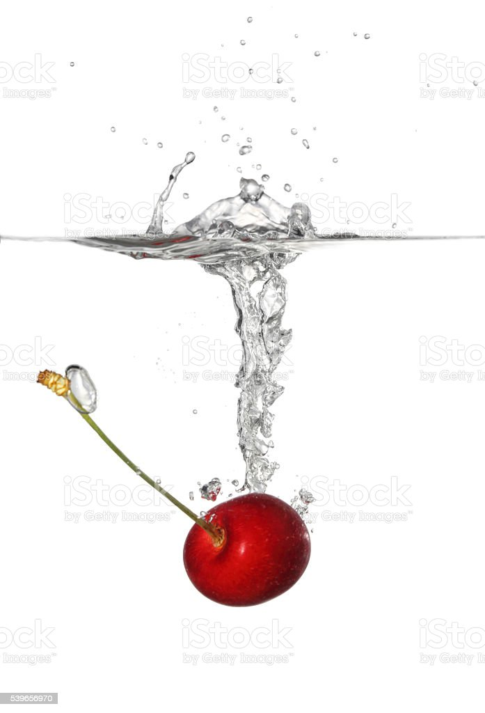 Splashing Cherry into Water stock photo