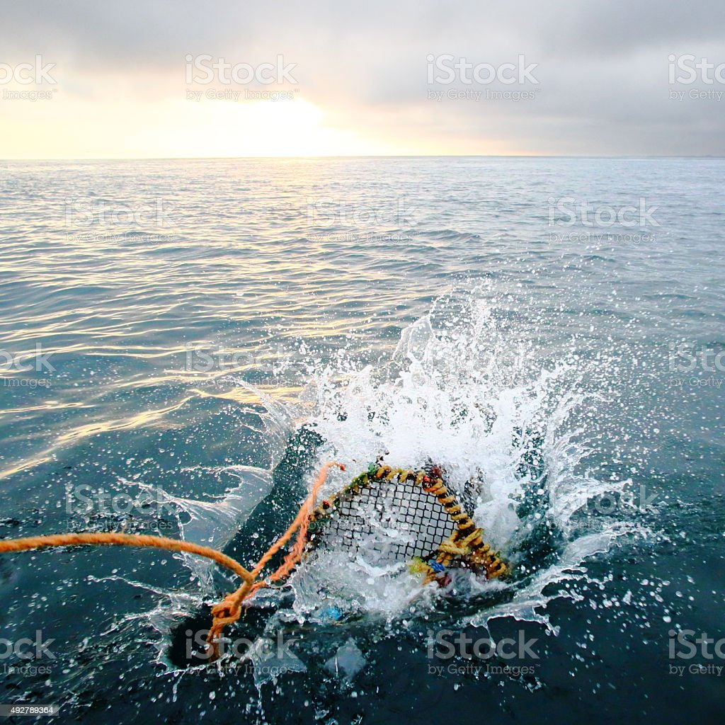 Splashing creel in the sea at dawn stock photo