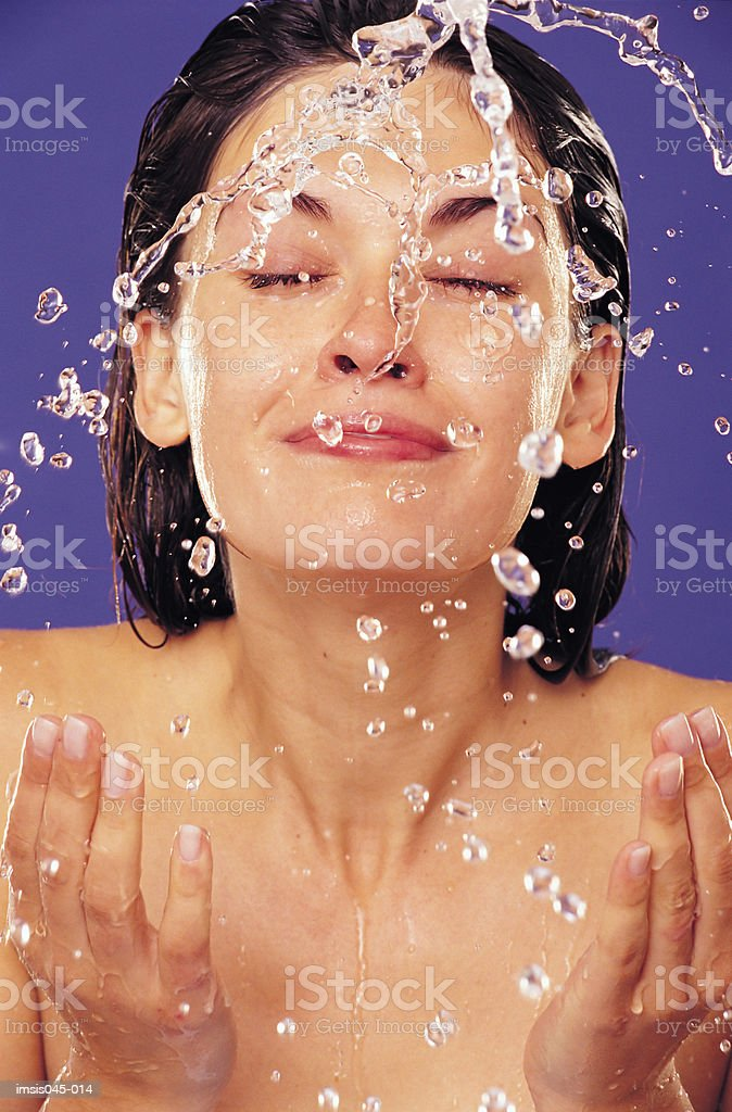 Splashing face royalty free stockfoto