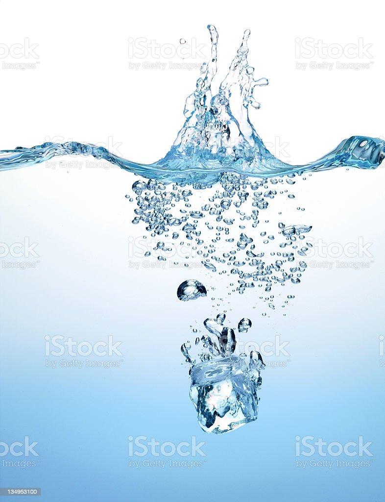 Splashing ice cube royalty-free stock photo