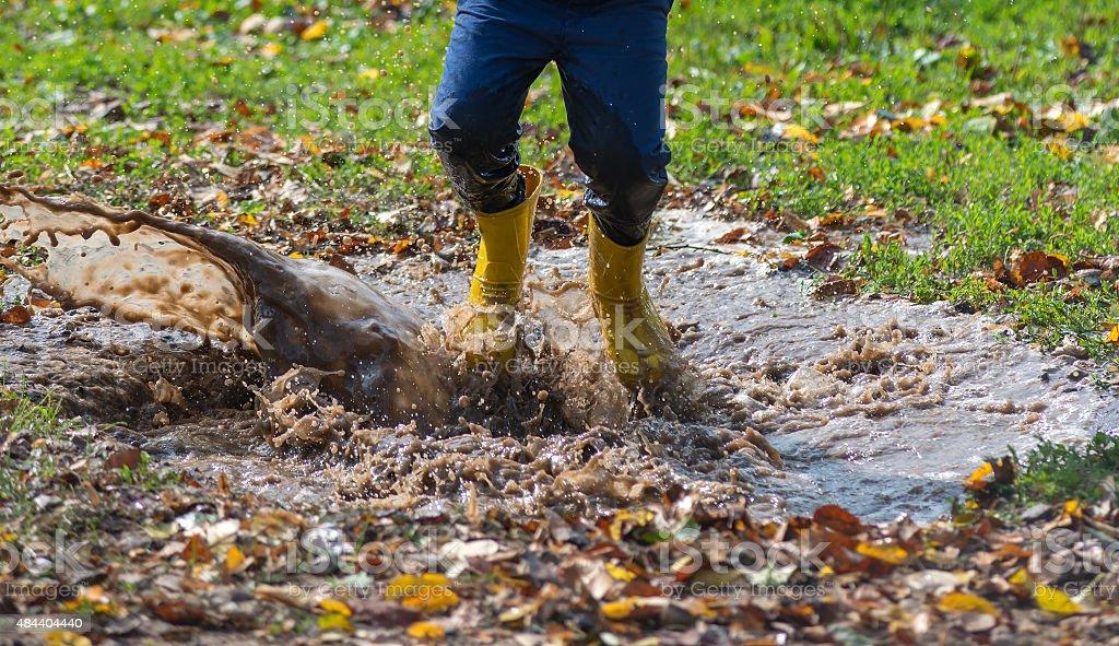 Splashing in puddle stock photo