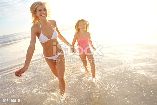 istock Splashing in the surf with mom 517419815
