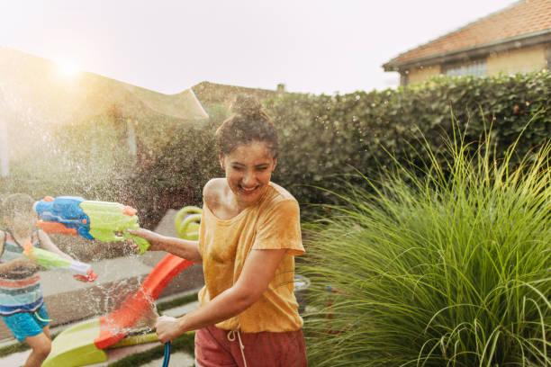 Splashing in the yard stock photo