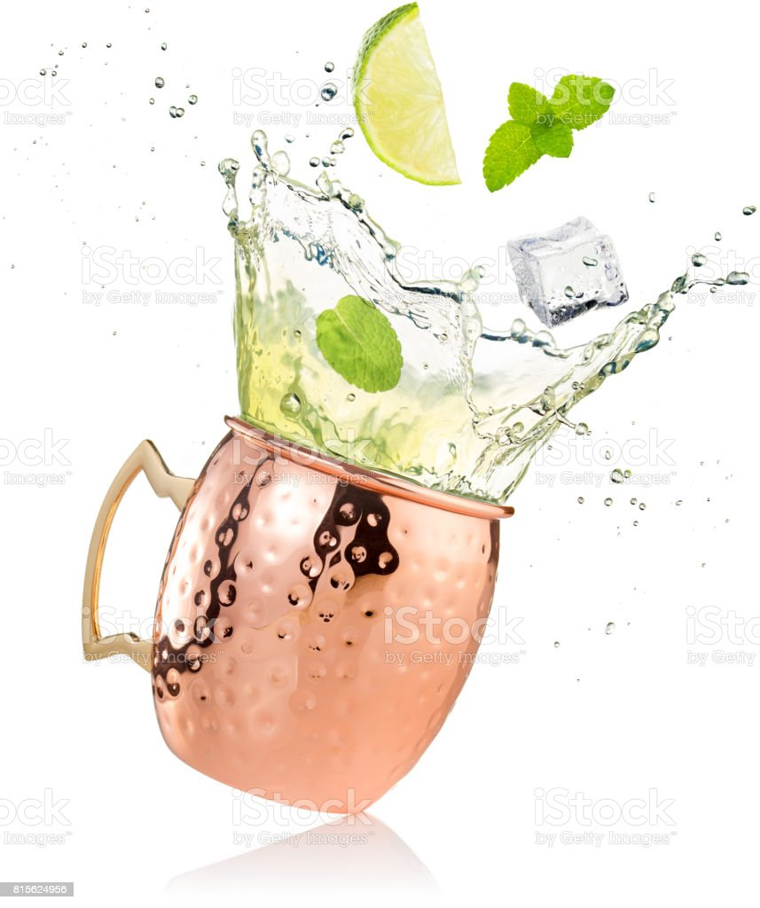 splashing moscow mule cocktail in copper mug stock photo