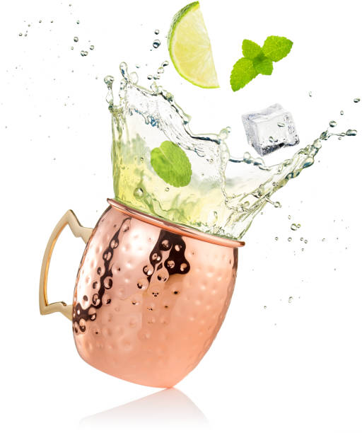 splashing moscow mule cocktail in copper mug splashing moscow mule cocktail in copper mug isolated on white moscow russia stock pictures, royalty-free photos & images