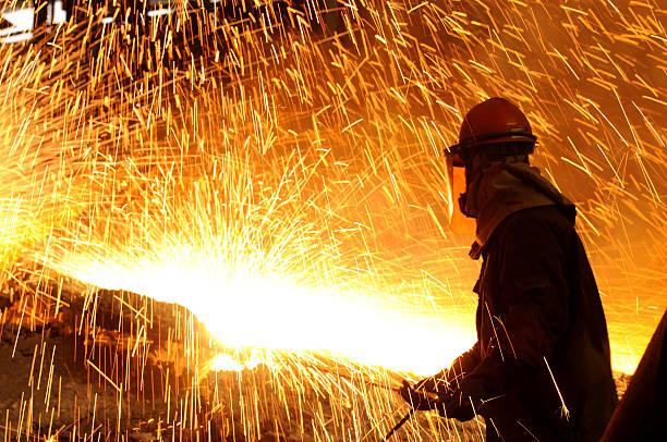 splashing of iron water - metallurgy stock photos and pictures