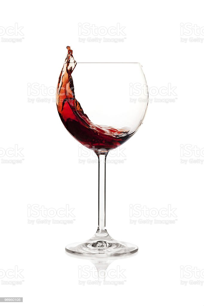 Splashing red wine in a glass royalty-free stock photo