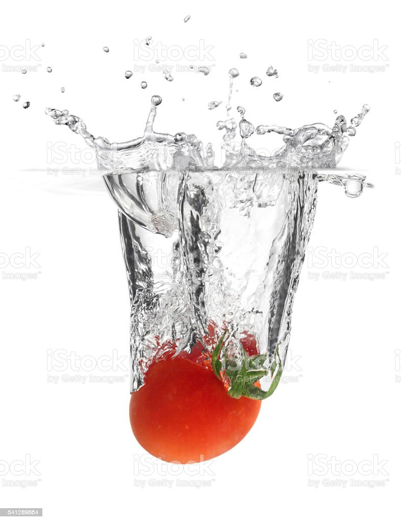 Splashing Tomato into Water stock photo