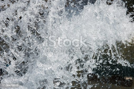 859844580istockphoto Splashing water. Summer and fountain. 1156476653