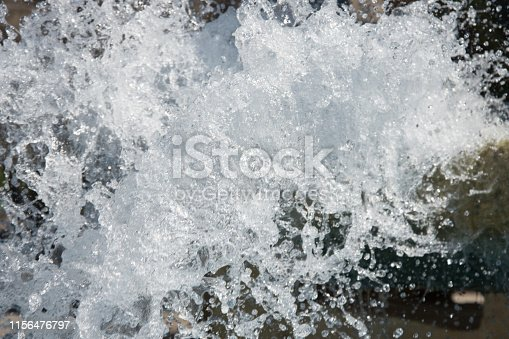 859844580istockphoto Splashing water. Summer and fountain. 1156476797