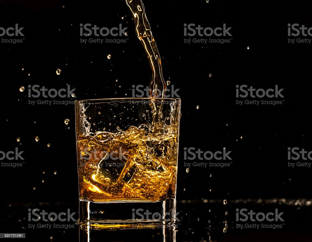 Splashing whiskey stock photo