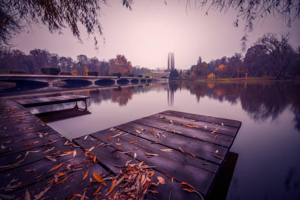 Splendid autumn scene in a park near the lake by a pontoon stock photo