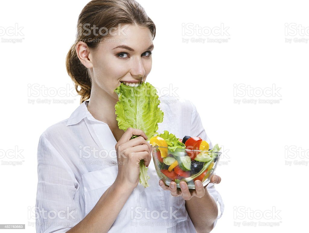 splendid european woman & vegetable salad - isolated on white stock photo