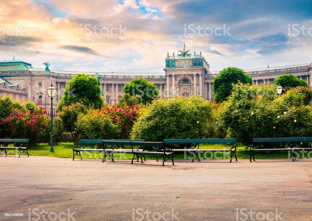Splendid morning view of  Volksgarten with Hofburg Imperial Palace Splendid morning view of  Volksgarten with Hofburg Imperial Palace. Sunny spring cityscape in Vienna, capital of Austria, Europe. Artistic style post processed photo. Adventure Stock Photo