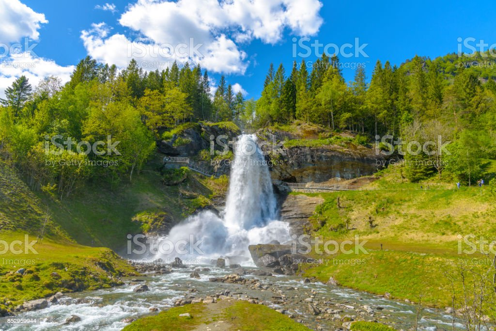 Splendid summer view with popular waterfall Steinsdalsfossen on the Fosselva River stock photo