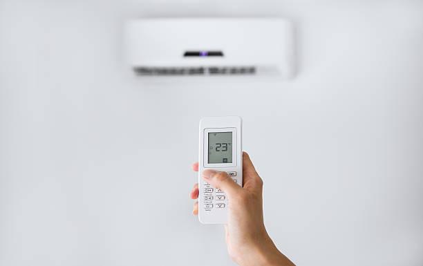 split air conditioner on a white wall. - kvinna ventilationssystem bildbanksfoton och bilder