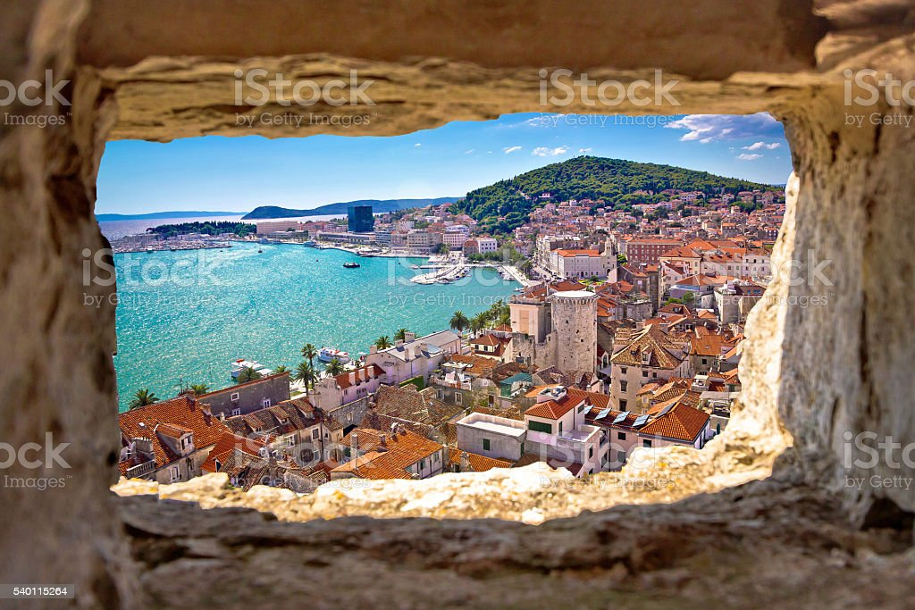 Split bay aerial view through stone window stock photo