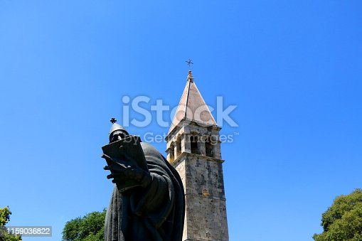 Historical bell tower and statue of bishop Grgur Ninski, landmarks in Split, Croatia.