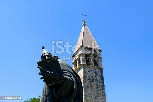 Historical bell tower and statue of bishop Grgur Ninski, landmarks in Split, Croatia.