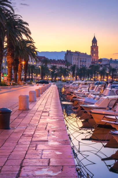 Split during sunrise, fishing boats at the promenade - beautiful Croatia stock photo