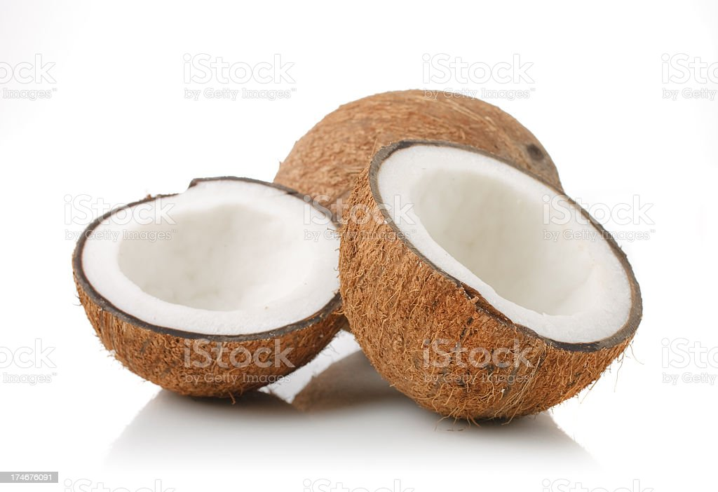 Split open coconut on white background royalty-free stock photo