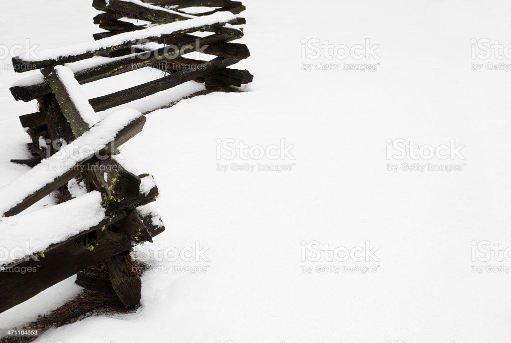 Split rail fence in the snow stock photo