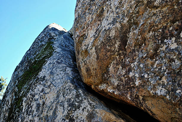 Split Rock Face 1 Looking up at some nice climbing rocks. neilliebert stock pictures, royalty-free photos & images