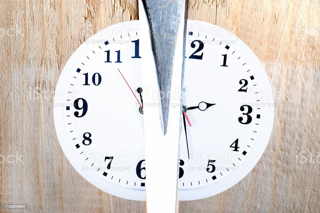Split Time. Concept of discord in plan and life. Broken time.